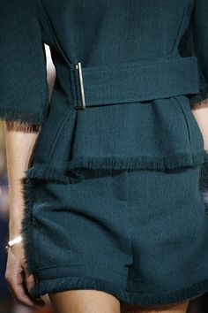 Jason Wu NYFW Close up - dark green frayed edge jacket with belted waist paired with co-ordinating frayed edge shorts which Vogue describes as having a 'safari feel' to them #SS16...x