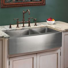 Striking stainless steel sink.    Optimum Stainless Steel 60/40 Offset Double Well Curved Apron Farmhouse Sink - 39""