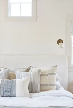 neutral bedroom decor with neutral bedding and neutral throw pillows, cottage bedroom design, coastal bedroom design, blue and white bedroom design, modern farmhouse bedroom with farmhouse throw pillows and bedroom sconce Stylish Bedroom, Cozy Bedroom, Modern Bedroom, Bedroom Decor, Bedroom Sconces, Bedroom Ideas, Blue Bedroom, Large Bedroom, Master Bedroom
