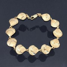 Items similar to Vintage Solid Yellow Gold Sea Shell Link Chain Bracelet 7 Length on Etsy 14k Gold Bracelet, Sea Shells, Chain, Trending Outfits, Yellow, Unique Jewelry, Link, Bracelets, Handmade Gifts