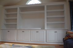 built-ins in dinning room? Larger cabinet bases for kids toys though. middle to serve as buffet.