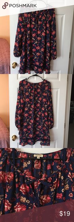 Lily White Dress/Tunic. Worn once. Floral print. Sheer navy with floral print. Tie neck. Comes with slip in navy color. I wore it once but it is a little big on me, so I haven't worn it again. Great for work! Lily White Dresses Midi