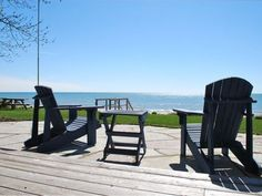 Beachfront deck and flagstone patio steps from the beach and Lake Michigan