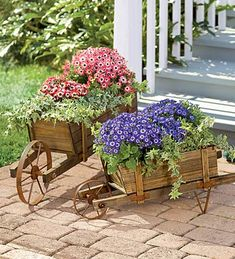 Large Wood Wheelbarrow and also a smaller one loaded with beautiful flowers......Love these, makes a pretty scene!!