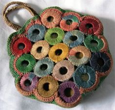 "Crocheted ""Coin Purse"" incorporating Indian holed-anna coins made by Chitra Balasubramaniam's mother. Probably silk thread; copper coins. Chittoor, Palakkad, Kerala, India. Late 1950s...Amazing!"