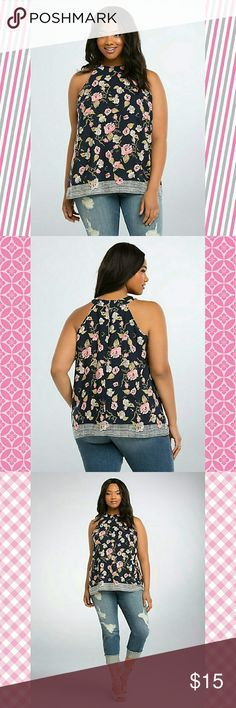 "Floral Border Tank Top The kind of tank top that stays classy no matter what you pair it with. The high neck design keeps it chic with silky navy challis that's printed with a femme floral print. The abstract dotted border makes it perfect for the modern girl.     Model is 5?11?, size 1      Size 1 measures 29 1/4"" from shoulder     Polyester     Wash cold, dry low     Made in USA plus size top torrid Tops Tank Tops"