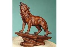 Image result for howling wolf wood carving