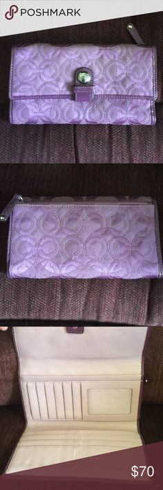 Coach Wallet Purple Coach wallet, fabric with embossed Coach logo. Barely used. Lots of credit card slots and room for checkbook and cash. Zippered coin purse on back. Bags Wallets