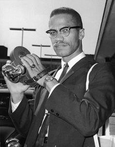 Malcolm X arriving at Heathrow Airport, photogrpahed by Terry Disney, 1964