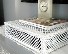 """""""hubs built this simple frame and covered it with radiator metalas a way to camoflauge the satellite box and still have the remote signal work is anyone interested in instructions for this?"""" YES! What a great idea."""