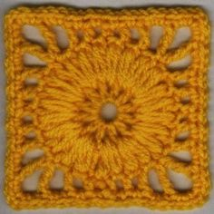 Bring the sun into someone's life with the Wagon Wheel Puff Motif Pattern. This sunny crochet granny square pattern is full of vitality. Using a long crochet puff stitch, this fun motif really pops! Crochet Squares Afghan, Crochet Motifs, Crochet Blocks, Granny Square Crochet Pattern, Crochet Granny, Crochet Stitches, Free Crochet, Knit Crochet, Granny Squares