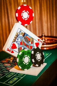 would be neat and i could use chew containers and paint them to look like poker chips and attatch playing cards to them.