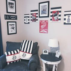 Baby boy red and navy hockey themed nursery using Detroit Red Wings and The University of Michigan! Canvas prints handmade using metal signs purchased from Amazon.