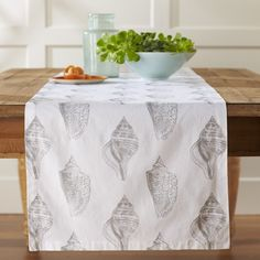Williams Sonoma, Shell Botanical Table Runner, $40   Beautiful Backdrop Of  Weathered Wood