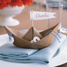 Set a shipshape table with seaworthy vessels whose sails designate guests' seats. These whimsical place cards require little more than kraft paper and a simple folding technique. Outfit boats with Life Savers candies and cast them adrift on blue napkins. Sports Wedding, Boat Wedding, Yacht Wedding, Nautical Wedding, Diy Wedding, Wedding Ideas, Wedding Blog, Wedding Flowers, Diy Place Cards