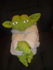 How to Fold a Towel Yoda Supplies Needed to Make Towel Yoda 1 Green Hand Towel 1 Green Bath Towel 1 Brown Bath Towel or Brown Hand Towel 2 Paper Eyes How to Fold a Towel Yoda Head Hang the center o… Brown Hand Towels, Hang Towels In Bathroom, Baby Shower Gifts, Baby Gifts, Towel Origami, Towel Animals, How To Fold Towels, Christmas Towels, Towel Cakes