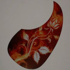 """Acoustic Guitar Custom Pickguard - Flowers / Flames by AxetremeCreations. $19.99. ***THESE ARE MADE TO FIT MOST MODEL ACOUSTIC GUITARS, PLEASE CHECK YOURS FIRST! Since 1850 B.C. , musicians have been playing some form of the acoustic guitar. Finally....we are giving them STYLE and PERSONALITY for their instrument!! These custom pickguards are made of a .035"""" material with a high quality adhesive on the back, meaning no sticky mess and completely safe on all fini..."""