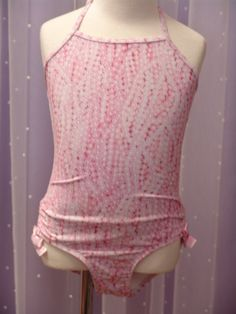 Kate Mack pearl print bathing suit, matching cover up available. At LuLu Belle Children's Boutique of Naples.