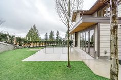 10 Plums by Wallmark Custom Homes, represents a one-of-a-kind opportunity for home buyers who are looking for a new or custom view home in North Vancouver. North Vancouver, Backyard, Patio, Custom Homes, Plum, Sidewalk, Side Walkway, Backyards, Walkway