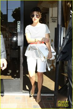 Kourtney Kardashian: Black Ad White Stripped Shirt (With A Red Belt Around The Waist), White Bermudas, And Beige Pointed Heels. A Great On-The-Go Look!