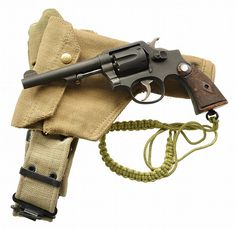 """World War II Smith & Wesson """"Australian Victory"""" Model double action revolver. Victory Models were Smith & Wesson Model 10 revolvers which were lend leased to Allied nations during World War II. Smith And Wesson Revolvers, Smith Wesson, Guns And Ammo, Weapons Guns, Shooting Guns, Fire Powers, Military Guns, War Machine, Shotgun"""