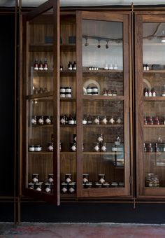 In Fiore, a cult parfumerie in San Francisco, designed by Matt Dick and owner Julie Elliot, featuring custom walnut shelving by woodworker Sebastian Parker. Photo by Mimi Giboin.
