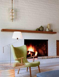 Beautifully streamlined floating wood mantel for retro interior. via houzz