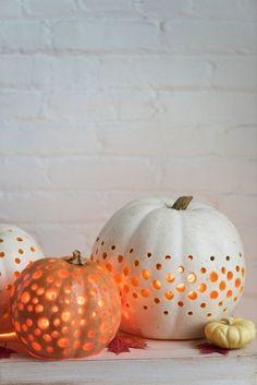 DIY Pumpkin Lanterns using a drill. Love this pumpkin carving idea for the Fall.