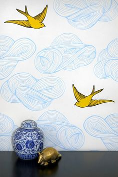 19 Modern Wallpapers for Your Nursery via Brit + Co.  Daydream Wallpaper ($125): The pretty yellow birds flitting about on this wallpaper are sure to catch your little one's eye every time.