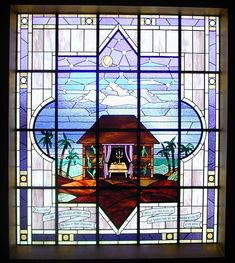 This window depicts a Sukkah,  for use during the week-long Jewish holiday of Sukkot. The sukkah itself symbolises the frailty and transience of life. In Judaism, a sukkah reminds its dwellers that true security comes from faith in God, rather than from money or possessions.