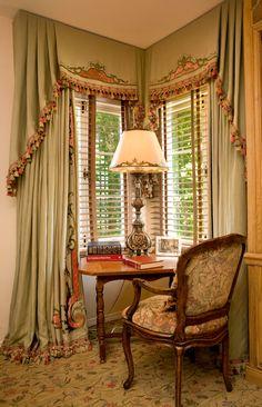 Lush corner window treatment. Beautiful embellishment & trim.