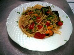 seafood pasta: linguine, fresh pachino tomatoes and mussels