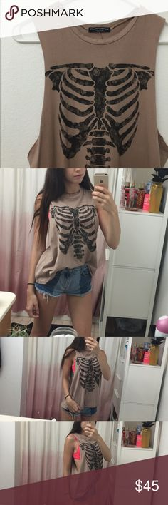 Brandy Melville skeleton shirt like new! Only wore a couple times • fits size SML • easy to dress up! Make a offer.  Brandy Melville Tops Muscle Tees