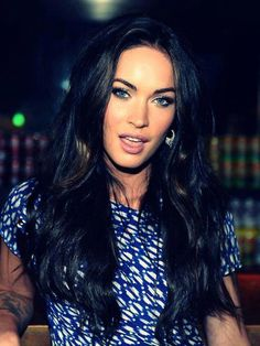Shiny dark long hair and a fierce look! We think Megan Fox could bowl anyone over in the boardroom! <3