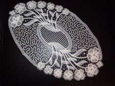 a mixture of part lace - flowers - and tape lace. possibly Idrija design, worked by Riva Mencacci