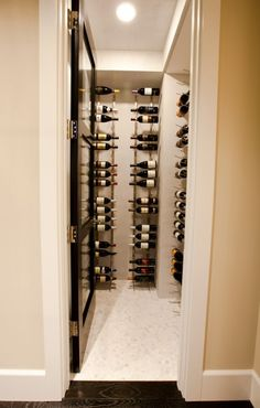 Hmmm...what one could do with an extra closet!  I do love the glass-panel door!