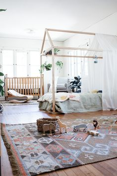 Gorgeous montessori style nursery of @calivintage P.S. I want that canopy bed for myself!