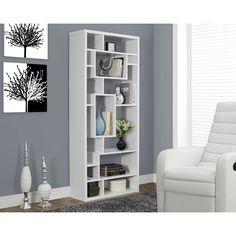 Store and display in style with the White Hollow-core Bookcase. Featuring a chic white finish and asymmetrical shelf design, this bookcase is sure to make a statement in any space.