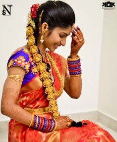 Stunning Red Silk Saree with Blue Blouse Featuring Embroidered Flowers and Traditional Pooja Jada