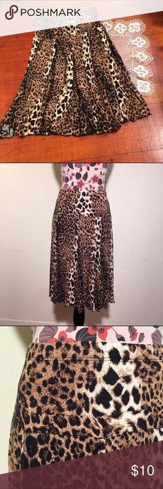 "Karen Kane leopard print skirt Soft leopard print skirt. The waist is 24"" and the length is 23"". The skirt is mostly a soft rayon. Karen Kane Skirts Midi"