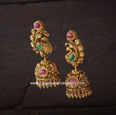 Stunningly designed antique finished gold jhumkas in intricate design. The mesmerizing peacock design eartops attached to jhumka hangings is studded with kundans. Gold Jhumka Earrings, Gold Earrings Designs, Gold Jewellery Design, Jhumka Designs, Gold Designs, Silver Jewellery, Art Designs, Diamond Jewelry, India Jewelry