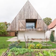 Gens Association Libérale d'Architecture designed this cozy Alsatian residence whose geometric gabled roof, clad in wood and tile, overlooks a small garden.📸: Ludmilla Cerveny. #architecture #facade #building #cabin #house #france