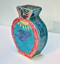 A colorful ceramic slab with a bird