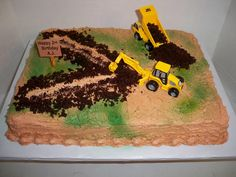 "The wonderful digger backhoe cake ( this isn't it) his mother made with ""sand"" and ""dirt"" and ""stones"" on it."