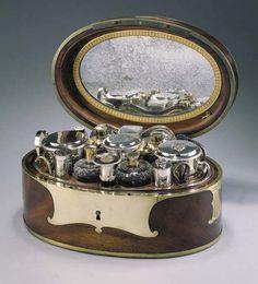 A superb French oval Mahogany Necessaire de Voyage box