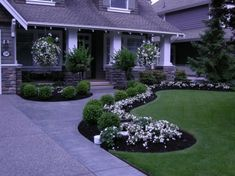 pretty-front-yard-landscaping-with-white-flowers-and-boxwood-roses-on-black-mulch-plus-turf-grass-for-traditional-exterior-with-wood-siding-also-white-columns-with-stone-at-bottom-615x460.jpg 615×460 pixels