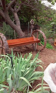 Tractor wheels added to a garden bench! See more here! More