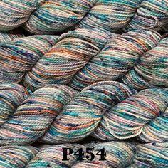 "Koigu Painter's Palette Premium Merino (KPPPM) Content: 100% Merino Wool Yarn Category: Fingering Weight/Yardage: 50 g / 170 yards Gauge: 7 sts = 1"" on US 3 Care: Hand wash cold, lay flat to dry Spun"