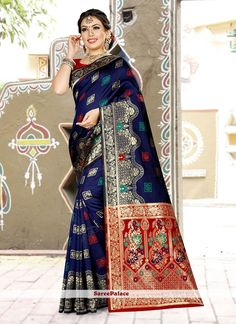 Buy latest collection of designer sarees including variety of sarees. Order this art banarasi silk navy blue designer traditional saree for ceremonial, festival, mehndi and sangeet. Art Silk Sarees, Banarasi Sarees, Art Marron, Art Rouge, Art Noir, Weaving Art, Fabric Weaving, Navy Blue Blouse, Red Saree