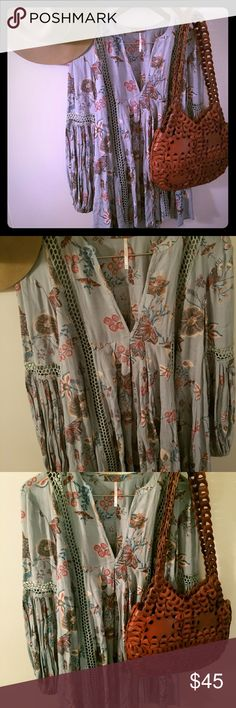 Free People tunic dress Beautiful floral tunic dress! Pair it with some booties and you will be ready for a night out. Super cute and flowy! Size xs. New without tags. Never worn. Free People Tops Tunics